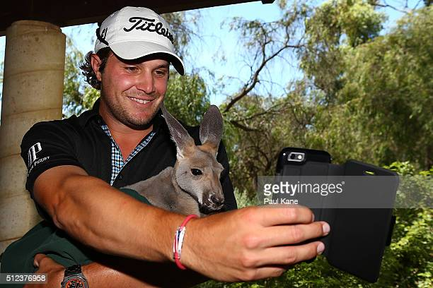 Peter Uihlein of the USA takes a selfie with Lilo the kangaroo during day two of the 2016 Perth International at Karrinyup GC on February 26 2016 in...