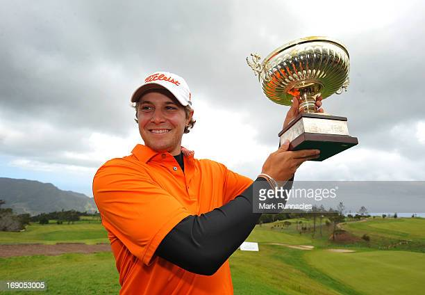 Peter Uihlein of USA poses with the trophy after winning the Madeira Islands Open Portugal BPI at Club de Golf do Santo da Serra on May 19 2013 in...