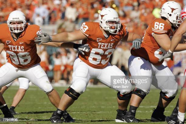 Peter Ullman Michael Huey and Buck Burnette of the Texas Longhorns move on the field during the game against the Nebraska Cornhuskers at Darrell K...