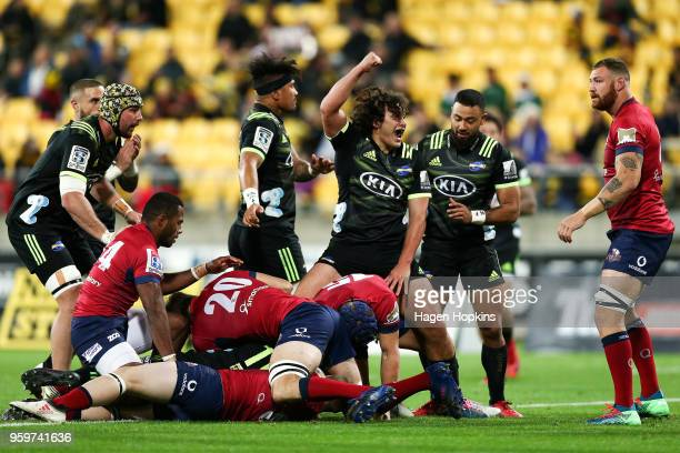 Peter UmagaJensen of the Hurricanes celebrates the try of teammate Jordie Barrett during the round 14 Super Rugby match between the Hurricanes and...