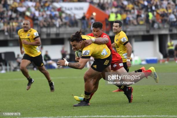 Peter Umaga-Jensen of the Hurricanes is tackled by Siosala Fifita of the Sunwolves during the round five Super Rugby match between the Hurricanes and...