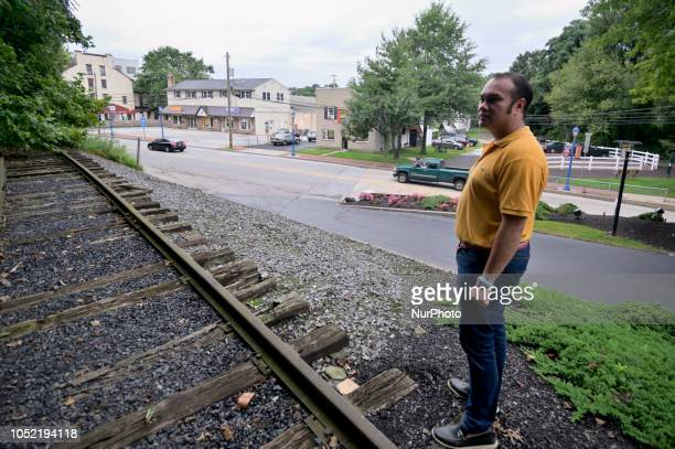 Peter Urscheler parttime mayor of the Borough of Phoenixville looks out over the tracks at the former train station in Phoenixville PA on august 21...
