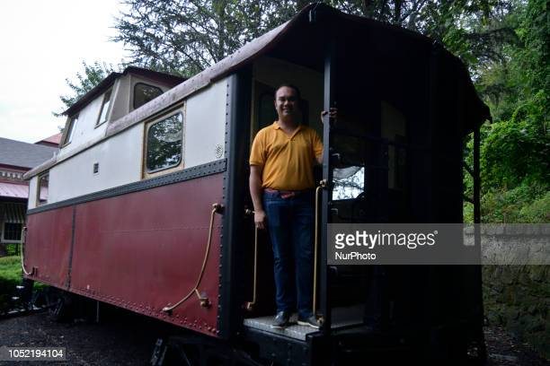 Peter Urscheler parttime mayor of the Borough of Phoenixville stands on the back of a stationary caboose located at the former train station in...