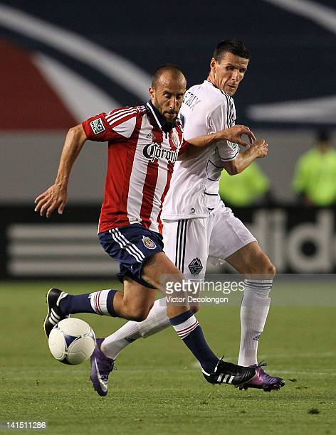 Peter Vagenas of Chivas USA protects the ball from Sebastien Le Toux of the Vancouver Whitecaps in the first half during the MLS match at The Home...