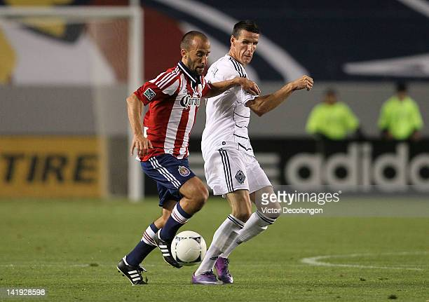 Peter Vagenas of Chivas USA Sebastien Le Toux of the Vancouver Whitecaps vie for the ball in the first half during the MLS match at The Home Depot...