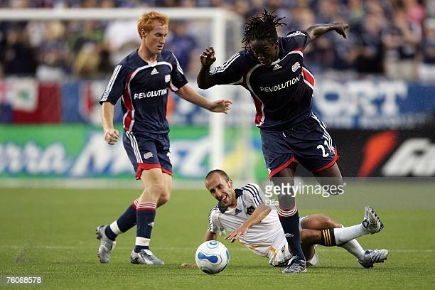Peter Vagenas of the Los Angeles Galaxy gets tripped up by Shalrie Joseph of the New England Revolution at Gillette Stadium on August 12 2007 in...