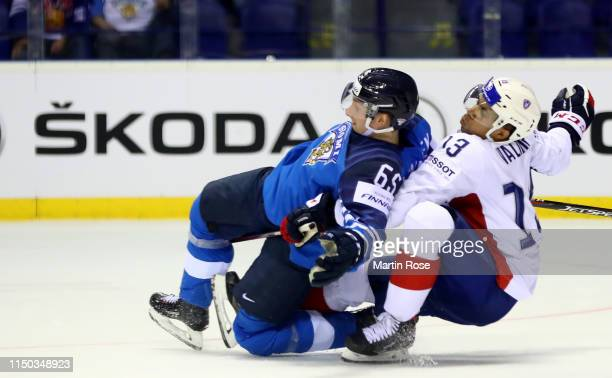 Peter Valier of France challenges Sakari Manninen of Finland during the 2019 IIHF Ice Hockey World Championship Slovakia group A game between France...