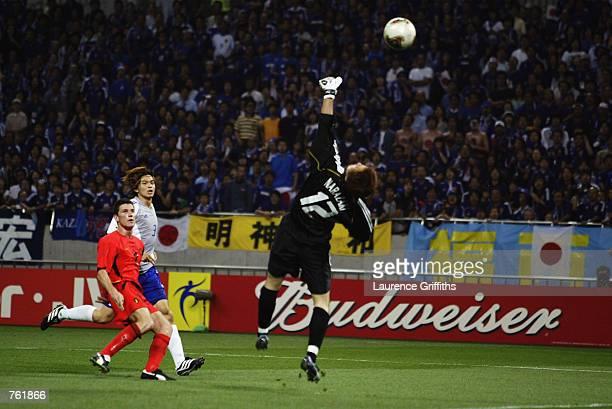 Peter van der Heyden of Belgium scores a goal during the Group H match of the World Cup Group Stage played at the Saitama Stadium SaitamaKen Japan on...
