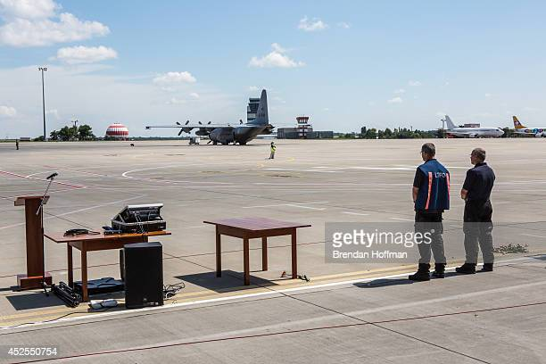Peter van Vliet leader of the Dutch forensics team investigating the crash of Malaysia Airlines flight MH17 watches a plane containing the bodies of...