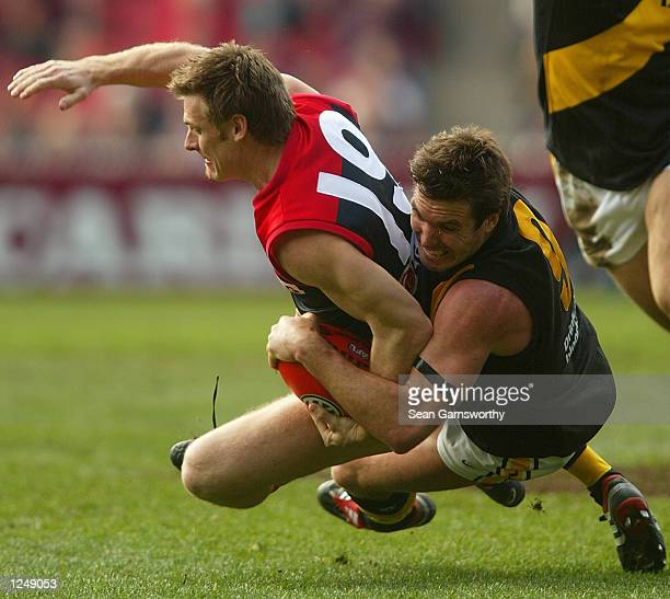 Peter Vardy for Melbourne is tackled to the ground by Wayne Campbell for Richmond during the round 18 AFL match between the Melbourne Demons and...