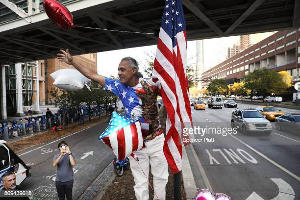Peter Velez a long time bicyclist places an American Flag on a pole at the scene of Tuesday's terrorist attack along a bike path in lower Manhattan...
