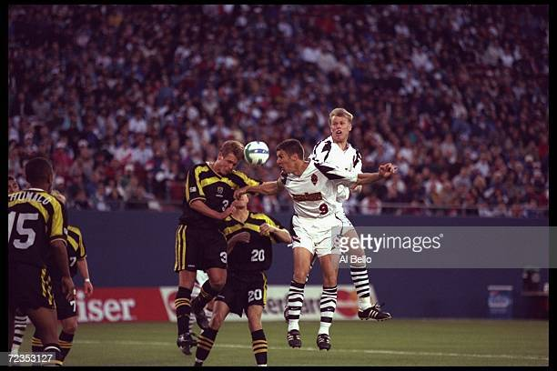 Peter Vermes of the New York/New Jersey Metrostars fights Columbus Crew players Michael Clark and Brian McBride for the ball during an MLS game...
