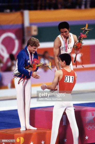 Peter Vidmar Koji Gushiken Li Ning Men's Gymnastics medal ceremony Pauley Pavilion at the 1984 Summer Olympics July 31 1984