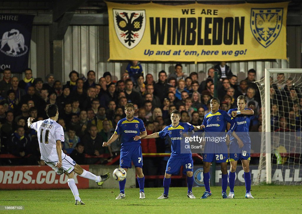Peter Vincenti (L) of Aldershot Town takes a free kick during the npower League Two match between AFC Wimbledon and Aldershot Town at the Cherry Red Records Stadium on November 17, 2012 in Kingston upon Thames, England.