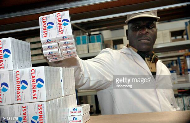 Peter Wafula a store assistant stacks medicines in a distribution center for Laborex Kenya a subsidiary of Eurapharma owned by CFAO in Nairobi Kenya...