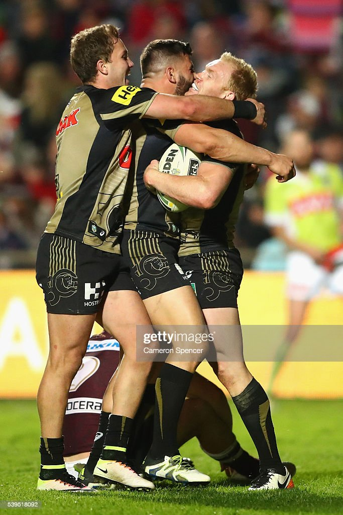Peter Wallace of the Panthers celebrates scoring a try with team mates during the round 14 NRL match between the Manly Sea Eagles and the Penrith Panthers at Brookvale Oval on June 12, 2016 in Sydney, Australia.