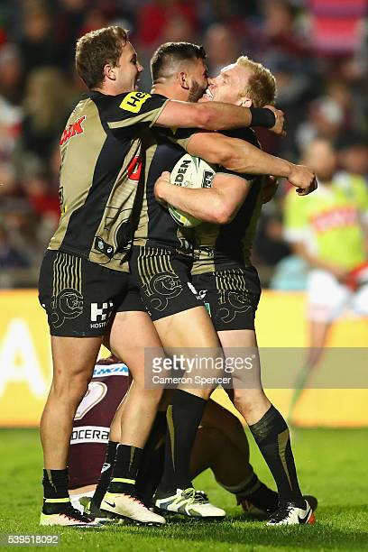 Peter Wallace of the Panthers celebrates scoring a try with team mates during the round 14 NRL match between the Manly Sea Eagles and the Penrith...