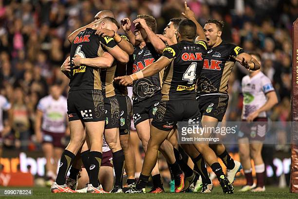 Peter Wallace of the Panthers celebrates scoring a try with team mates during the round 26 NRL match between the Penrith Panthers and the Manly Sea...