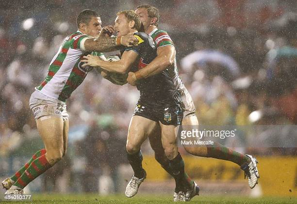 Peter Wallace of the Panthers is tackled by Luke Burgess and George Burgess of the Rabbitohs during the round 6 NRL match between the Penrith...