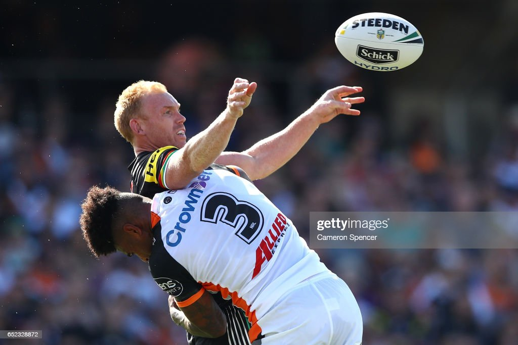 Peter Wallace of the Panthers offloads the ball in a tackle during the round two NRL match between the Wests Tigers and the Penrith Panthers at Campbelltown Sports Stadium on March 12, 2017 in Sydney, Australia.