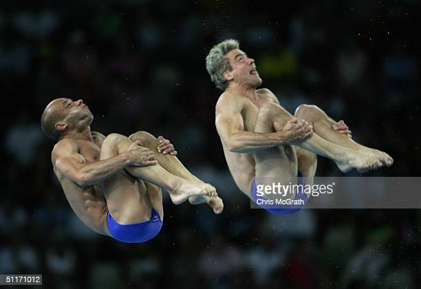 Peter Waterfield and Leon Taylor of Great Britain compete in the men's synchronised diving 10 metre platform event on August 14 2004 during the...