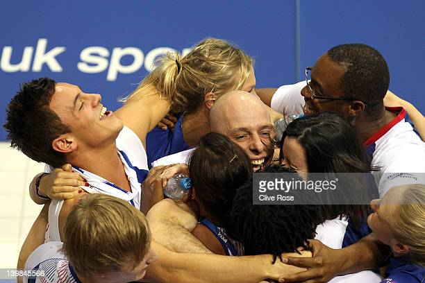 Peter Waterfield of Great Britain is congratulated by his teammates including Tom Daley after taking the bronze medal in the Men's 10m Platform final...
