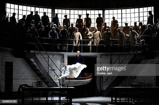 Peter Wedd as Lohengrin and Daniel Williams as Gottfried with artists of the company in Welsh National Opera's production of Richard Wagner's...