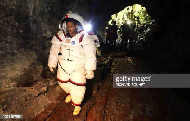 Peter Weiss director of the Space Department of COMEX tests a pressurized suit identical to those used in space expeditions in the lava tunnel of...