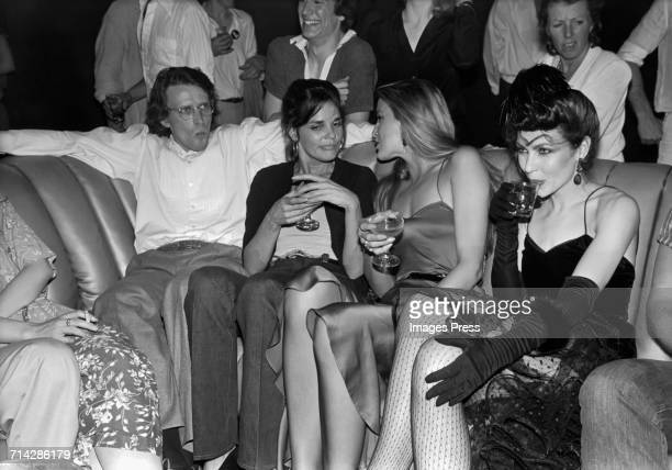 Peter Weller, Ali McGraw, Jerry Hall and a mystery guest at Studio 54 circa 1979 in New York City.