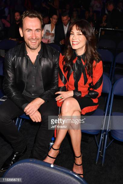 Peter White and Michelle Monaghan attend the 2019 CMT Music Awards at Bridgestone Arena on June 05 2019 in Nashville Tennessee