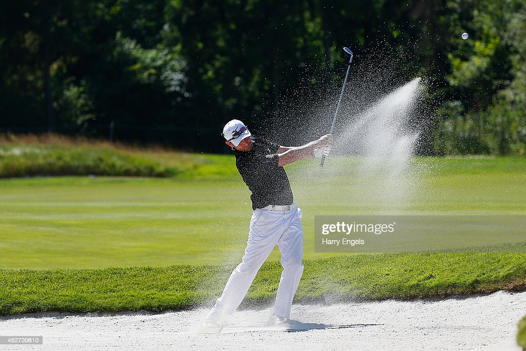 Peter Whiteford of Scotland hits out of a bunker at the eighth on day three of the M2M Russian Open at Tseleevo Golf & Polo Club on July 26, 2014 in Moscow, Russia.