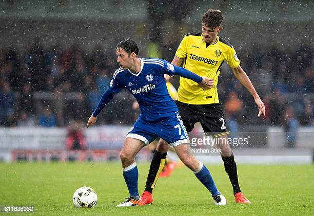 Peter Whittingham of Cardiff City and Tom Flanagan of Burton Albion in action during the Sky Bet Championship match between Burton Albion and Cardiff...