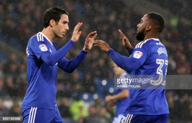 Peter Whittingham of Cardiff City celebrates scoring his sides first goal of the match from a penalty with team mate Junior Hoilett during the Sky...