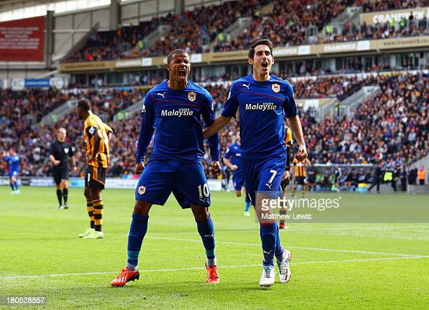 Peter Whittingham of Cardiff City celebrates with Fraizer Campbell as he scores their first goal during the Barclays Premier League match between...