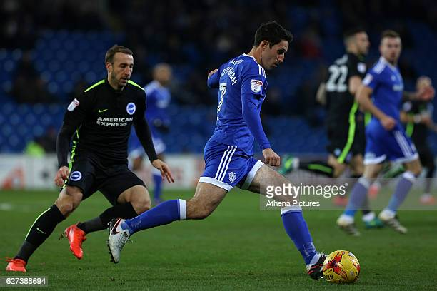 Peter Whittingham of Cardiff City is closely marked by Glenn Murray of Brighton and Hove Albion during the Sky Bet Championship match between Cardiff...
