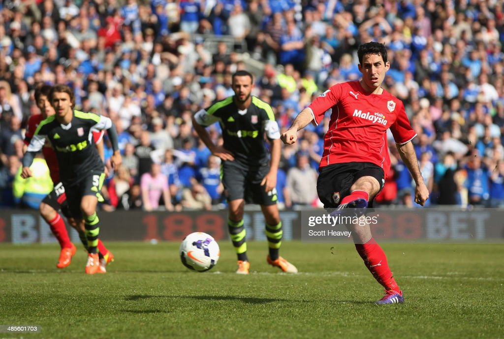Peter Whittingham of Cardiff City scores their first goal from a penalty kick during the Barclays Premier League match between Cardiff City and Stoke City at Cardiff City Stadium on April 19, 2014 in Cardiff, Wales.