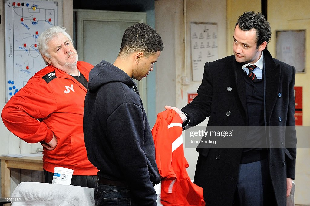 Peter Wight, as Yates, Calvin Demba, as Jordan and Daniel Mays, as Kidd perform on stage during a performance of 'The Red Lion' a new play by Patrick Marber at The National Theatre on June 9, 2015 in London, England.