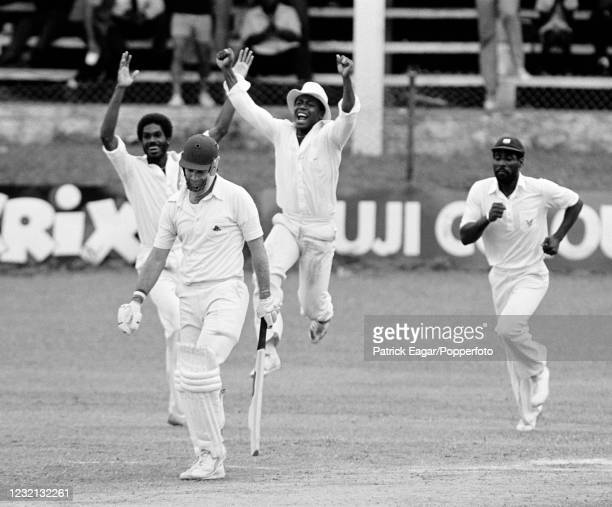 Peter Willey of England is caught for 21 runs by West Indies captain Clive Lloyd and England are nine wickets down following on in the 1st Test match...