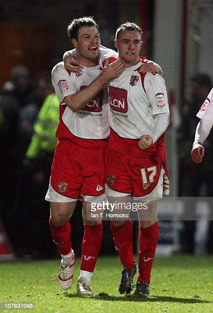 Peter Winn of Stevenage is congratulated for his goal by team-mate Scott Laird during the FA Cup sponsored by e.on 3rd round match between Stevenage...