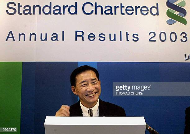 Peter Wong director of Standard Chartered Bank smiles at a press conference as the bank announces its 2003 results in Hong Kong 18 February 2004...