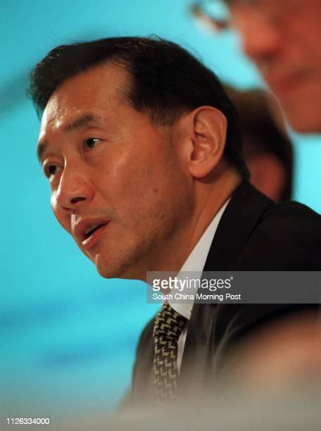 Peter Wong Tungshun chief executive of Standard Chartered Bank speaks in their results press conference on 7 August 2002