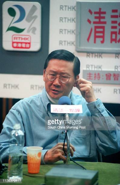 Peter Woo Kwongching scratches his ear during an interview by RTHK's Tsang Chiwah's talk show 16 jan 99