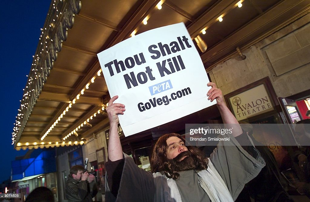 Peter Wood, an activist with People for the Ethical Treatment of Animals (PETA), protests at the Avalon Theater during the premiere of Mel Gibson's 'The Passion of the Christ' February 25, 2004 in Washington, DC.