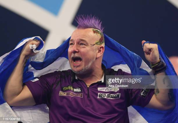 Peter Wright celebrates victory after the Final of the 2020 William Hill World Darts Championship between Peter Wright and Michael van Gerwen at...
