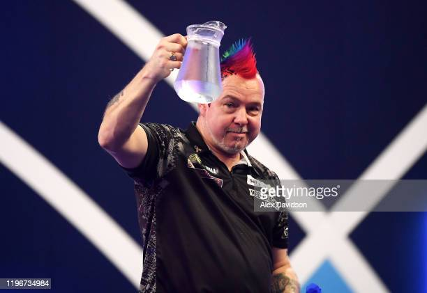 Peter Wright celebrates victory after the SemiFinal match between Peter Wright and Gerwyn Price on Day 15 of the 2020 William Hill World Darts...