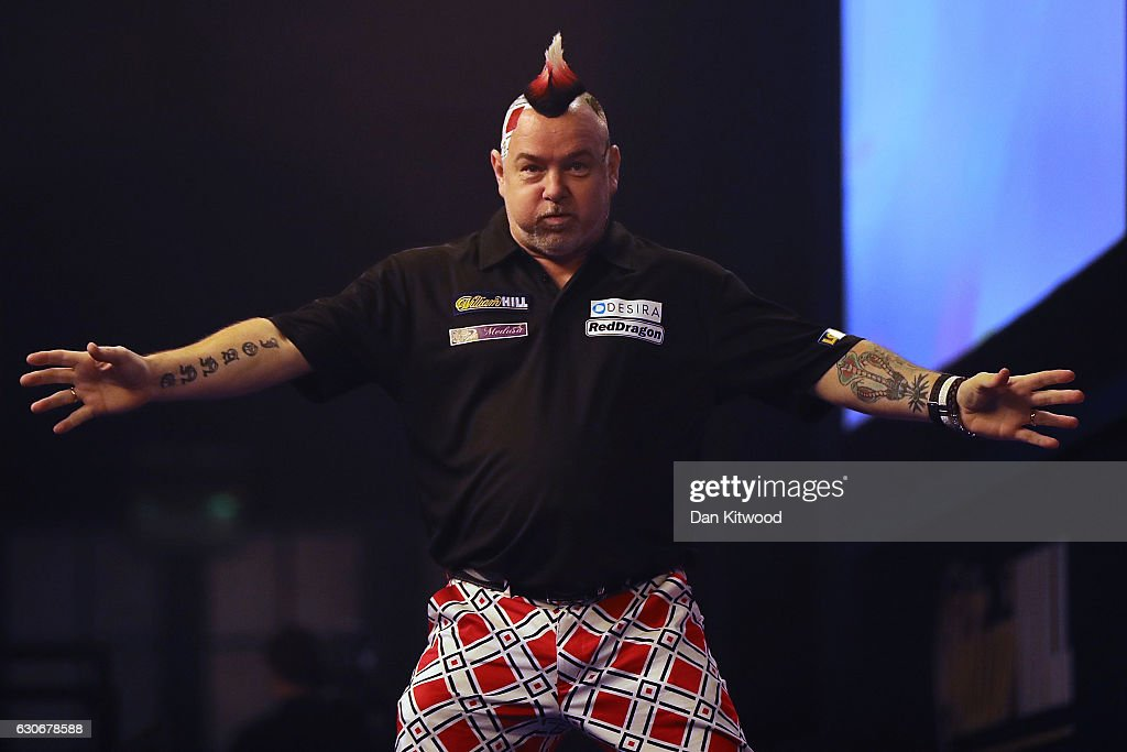 Peter Wright from Scotland celebrates after throwing a 180 during the quarter final of 2016 William Hill World Darts Championship on December 30, 2016 in London, England. The event is world's biggest darts tournament, with 72 players from across the globe competing across 15 days of the knock out competition.