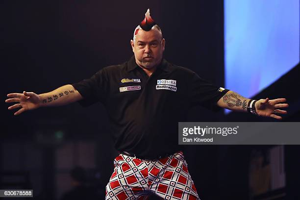 Peter Wright from Scotland celebrates after throwing a 180 during the quarter final of 2016 William Hill World Darts Championship on December 30 2016...