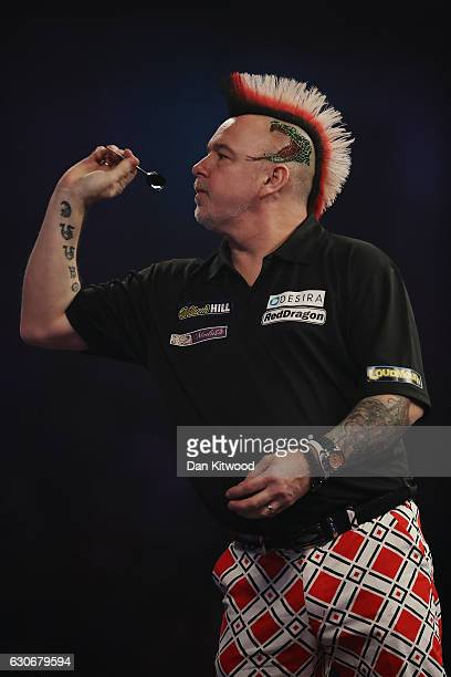 Peter Wright from Scotland plays James Wade from the United Kingdom during the quarter final of 2016 William Hill World Darts Championship on...