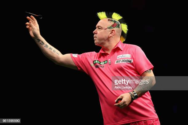 Peter Wright in action during his match against Michael Smith in the 2018 Unibet Premier League at The Manchester Arena on April 26 2018 in...