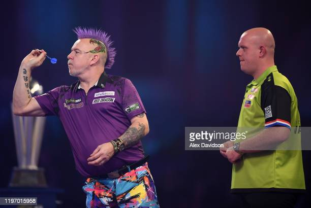Peter Wright in action during the Final of the 2020 William Hill World Darts Championship between Peter Wright and Michael Van Gerwen at Alexandra...